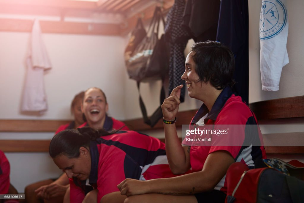 Rugby players laughing together in changing room : Stock Photo