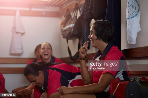 Rugby players laughing together in changing room