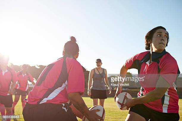 Rugby players practicing in the field