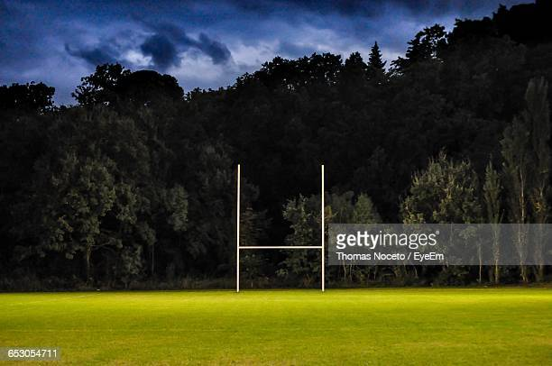 Rugby Post On Empty Field Against Cloudy Sky