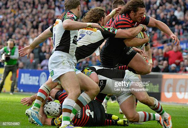 Rugby Premier League Saracens v Harlequins at Wembley Stadium London UK In front of a word record crowd of over 83000 Saracens Marcelo Bosch bursts...