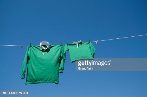 Rugby shirts drying on string