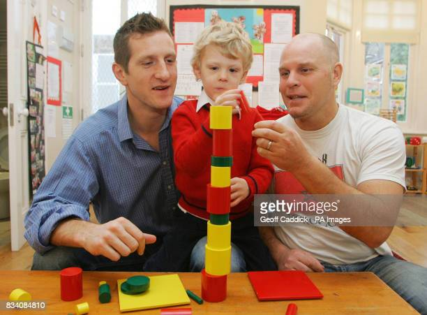 Rugby star Will Greenwood joins his son Archie who is almost four and male care worker Sean Daly as Archie builds a tower made from wooden blocks at...