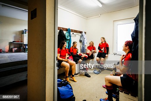 Rugby team having a break in the locker room