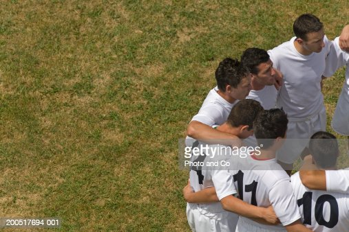 Rugby team standing in circle on pitch, overhead view : Stock Photo