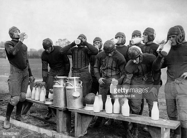 Rugby teams Rugby players drinking milk during a break 1928 Vintage property of ullstein bild