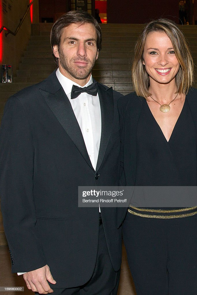 Rugbyman Gonzalo Quesada (L) and his wife, sports journalist Isabelle Ithurburu, attend the GQ Men of the year awards 2012 at Musee d'Orsay on January 16, 2013 in Paris, France.