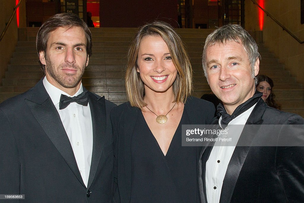 Rugbyman Gonzalo Quesada, his wife sports journalist Isabelle Ithurburu, and journalist Darren Tulett attend the GQ Men of the year awards 2012 at Musee d'Orsay on January 16, 2013 in Paris, France.