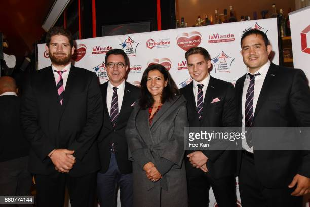 Rugbyman Pascal Pape poses with Anne Hidalgo and members of Le Stade Franais during the 'Boeuf A la Mode' Dinner Hosted by Les Artisans Bouchers de...