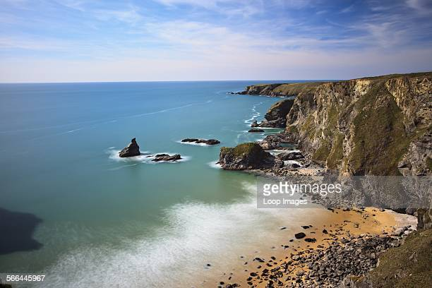 Rugged Cornish coastline at Bedruthan Steps named after a mythological giant 'Bedruthan' who was said to have used rock stacks on the beach as...