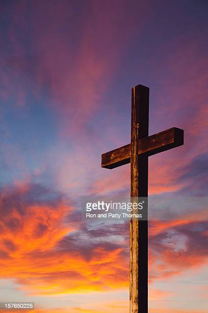 Rugged Wooden Cross Against Sunset Sky