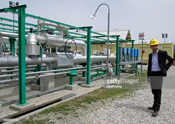 Ruggero Gheller head of southern Italy at Eni SpA poses for a photograph next to pipework at one of the company's oil wells in the Val d'Agri valley...