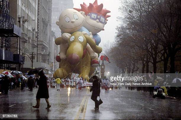 Rugrats balloon makes its way down Central Park West in the rain during the 72nd annual Thanksgiving Day Parade