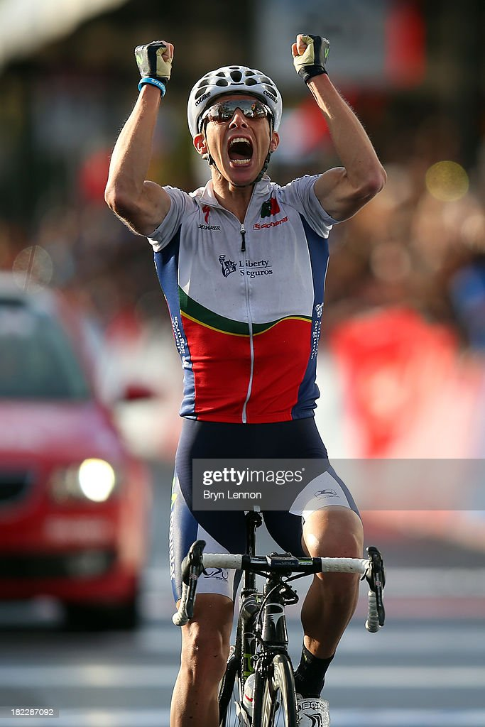 Rui Costa of Portugal celebrates crossing the finish line to win the Elite Men's Road Race, a 272km race from Lucca to Florence on September 29, 2013 in Florence, Italy.