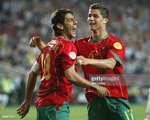 Rui Costa of Portugal celebrates with Ronaldo after scoring the second goal during the UEFA Euro 2004 Group A match between Russia and Portugal at...