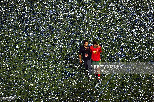 Rui Costa of Portugal leaves the field looking dejected during the UEFA Euro 2004 Final match between Portugal and Greece at the Luz Stadium on July...