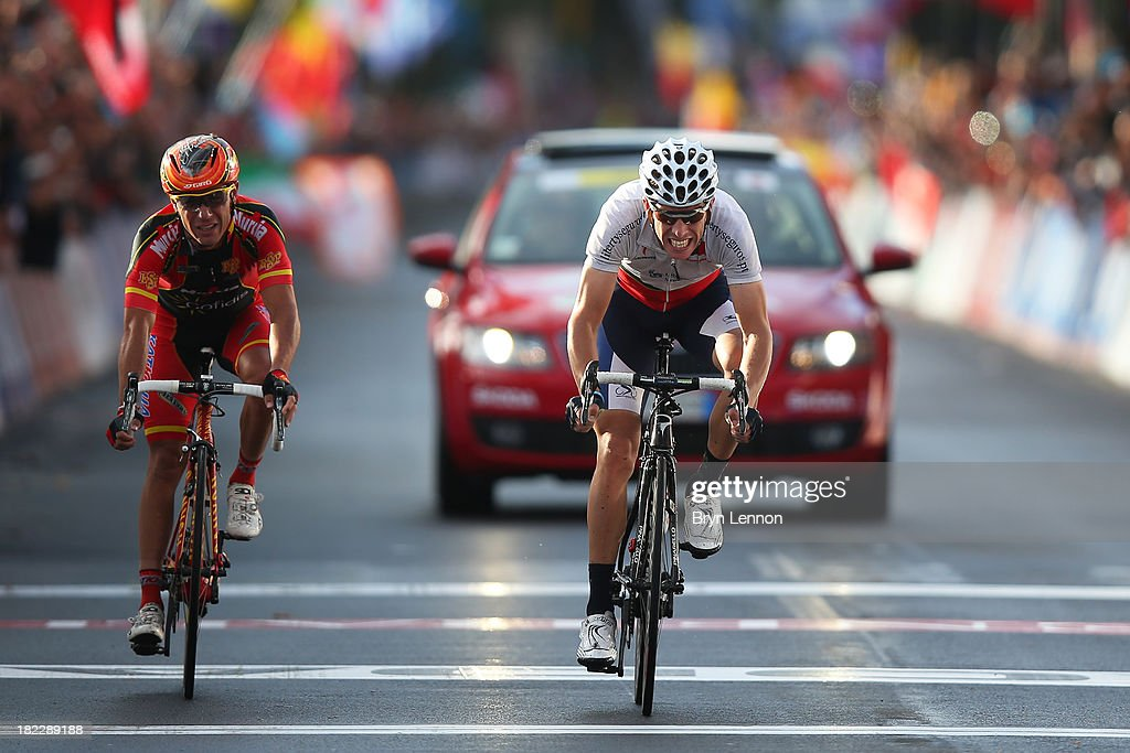 Rui Costa of Portugal (R) wins the sprint ahead of Joaquin 'Purito' Rodriguez of Spain for the finish line to win the Elite Men's Road Race, a 272km race from Lucca to Florence on September 29, 2013 in Florence, Italy.