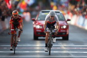 Rui Costa of Portugal wins the sprint ahead of Joaquin 'Purito' Rodriguez of Spain for the finish line to win the Elite Men's Road Race a 272km race...