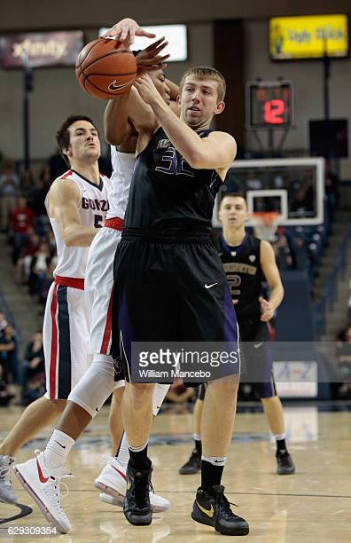 Rui Hachimura of the Gonzaga Bulldogs attempts to strip the ball from Greg Bowman of the Washington Huskies in the second half at McCarthey Athletic...