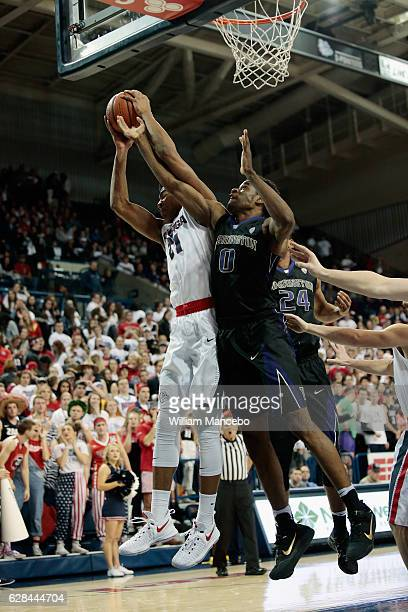 Rui Hachimura of the Gonzaga Bulldogs controls a rebound against Bitumba Baruti of the Washington Huskies in the second half at McCarthey Athletic...