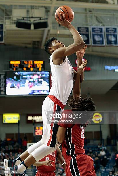 Rui Hachimura of the Gonzaga Bulldogs goes up for a shot against Brandon Armstrong of the South Dakota Coyotes in the second half at McCarthey...