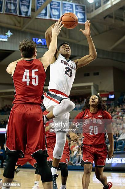 Rui Hachimura of the Gonzaga Bulldogs goes up for a shot against Austin Sparks and Brandon Armstrong of the South Dakota Coyotes in the second half...