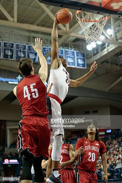 Rui Hachimura of the Gonzaga Bulldogs goes up for the dunk against Austin Sparks of the South Dakota Coyotes in the second half at McCarthey Athletic...