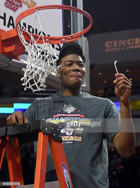Rui Hachimura of the Gonzaga Bulldogs reacts after cutting down a piece of a net following the team's 7456 victory over the Saint Mary's Gaels to win...