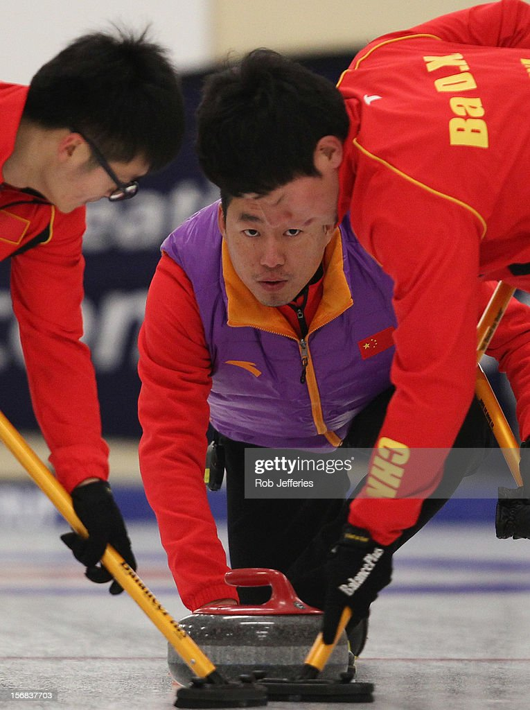 Rui Liu of China watches his stone intently during the Pacific Asia 2012 Curling Championship at the Naseby Indoor Curling Arena on November 23, 2012 in Naseby, New Zealand.