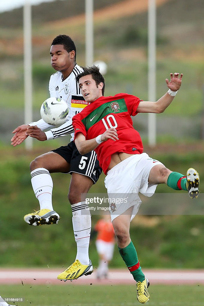 Rui Moreira (R) of Portugal challenges Jonathan Tah of Germany during the Under17 Algarve Youth Cup match between U17 Portugal and U17 Germany at the Stadium Bela Vista on February 12, 2013 in Parchal, Portugal.