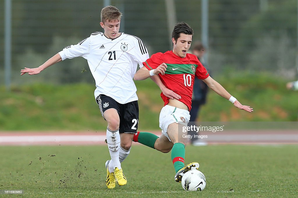 Rui Moreira of Portugal challenges Sinan Kurt of Germany during the Under17 Algarve Youth Cup match between U17 Portugal and U17 Germany at the Stadium Bela Vista on February 12, 2013 in Parchal, Portugal.