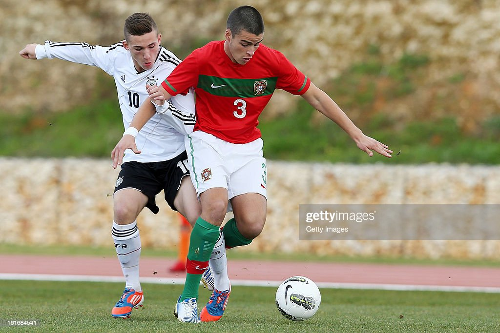 Rui Moreira of Portugal is challenged by Donis Avdijaj (L) of Germany during the Under17 Algarve Youth Cup match between U17 Portugal and U17 Germany at the Stadium Bela Vista on February 12, 2013 in Parchal, Portugal.