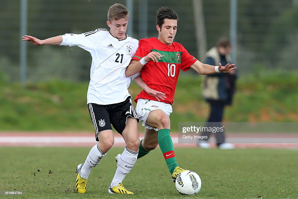 Rui Moreira (R) of Portugal shields the ball from Sinan Kurt of Germany during the Under17 Algarve Youth Cup match between U17 Portugal and U17 Germany at the Stadium Bela Vista on February 12, 2013 in Parchal, Portugal.