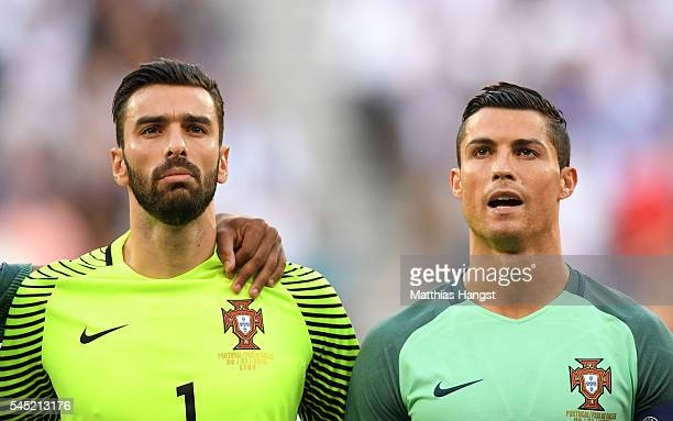 Rui Patricio and Cristiano Ronaldo of Portugal line up for the national anthem prior to the UEFA EURO 2016 semi final match between Portugal and...
