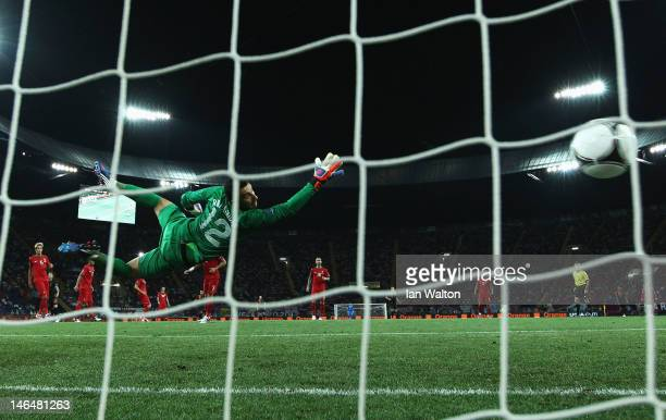 Rui Patricio of Portugal dives as he attempts to stop Rafael van der Vaart of Netherlands scoring the opening goal past during the UEFA EURO 2012...