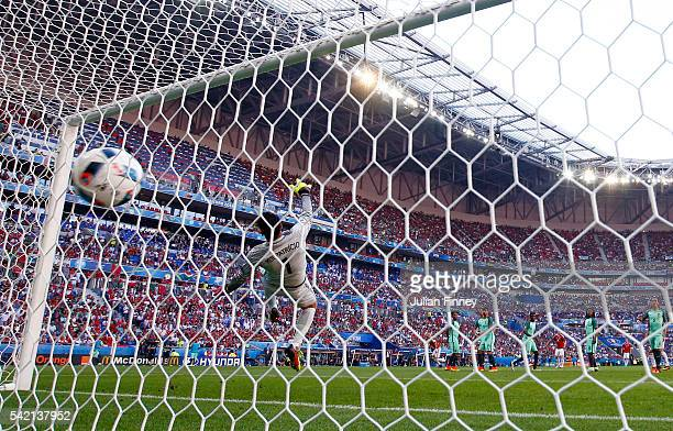 Rui Patricio of Portugal dives in vain as Balazs Dzsudzsak of Hungary scores his team's second goal from a free kick during the UEFA EURO 2016 Group...