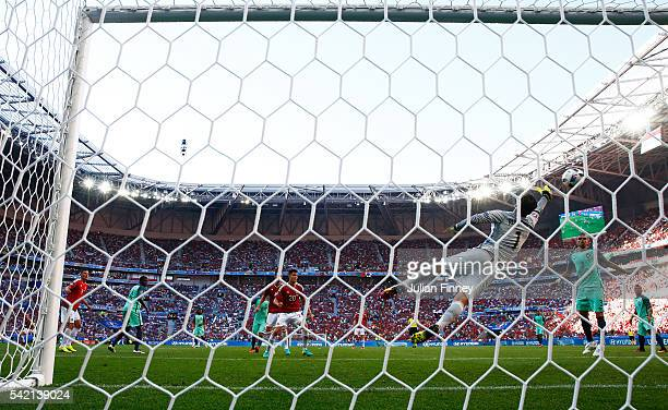 Rui Patricio of Portugal dives in vain as Balazs Dzsudzsak of Hungary scores his team's third goal during the UEFA EURO 2016 Group F match between...