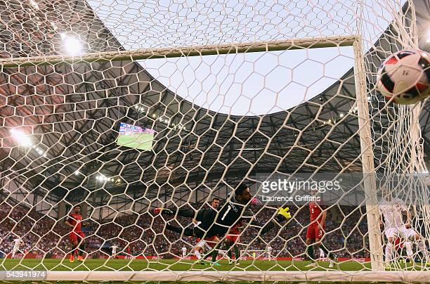 Rui Patricio of Portugal dives in vain as Robert Lewandowski of Poland scores the opening goal during the UEFA EURO 2016 quarter final match between...