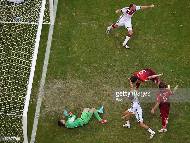 Rui Patricio of Portugal fails to save a penalty kick by Thomas Mueller of Germany for Germany's first goal during the 2014 FIFA World Cup Brazil...