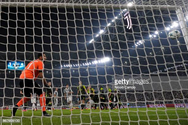 Rui Patricio of Sporting CP is beaten by a Miralem Pjanic free kick during the UEFA Champions League football match between Juventus FC and Sporting...