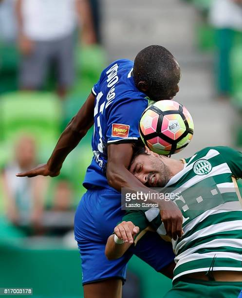 Rui Pedro of Ferencvarosi TC battles for the ball in the air with Patrick Mevoungou of Puskas Akademia FC during the Hungarian OTP Bank Liga match...