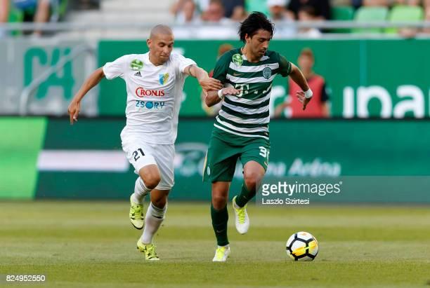 Rui Pedro of Ferencvarosi TC wins the ball from Jakub Brasen of Mezokovesd Zsory FC during the Hungarian OTP Bank Liga match between Ferencvarosi TC...