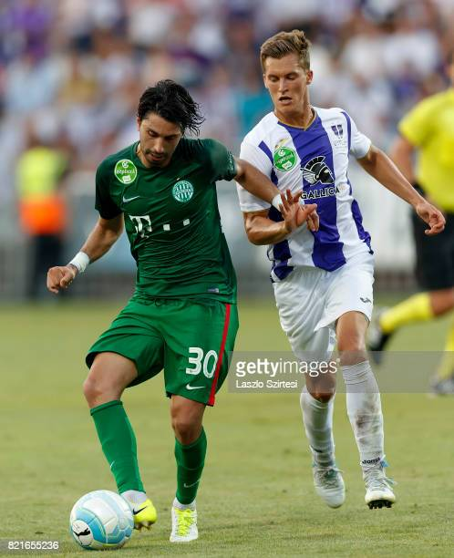 Rui Pedro of Ferencvarosi TC wins the ball from Jozsef Windecker of Ujpest FC during the Hungarian OTP Bank Liga match between Ujpest FC and...