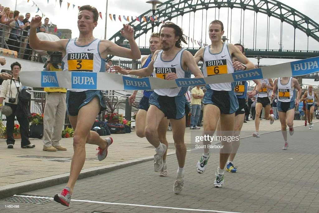 Rui Silva of Portugal celebrates after crossing the finish line to win the BUPA Great North Mile International Men's Race in a time of 4 minutes 12.4 seconds on October 5, 2002 in Newcastle, United Kingdom.