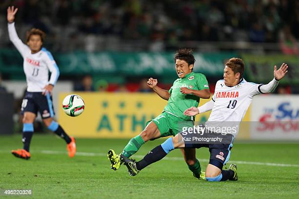 Ruiji Sugimoto of Tokyo Verdy and Masahiko Inoha of Jubilo Iwata compete for the ball during the JLeague second division match between Tokyo Verdy...