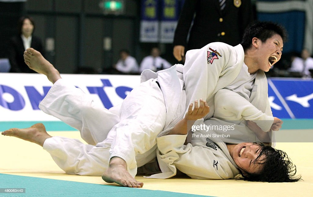 Ruika Sato (top) celebrates a Yuko point after throwing Akari Ogata in the Women's -78kg during the Kodokan Cup All Japan Judo Championships By Weight Category at Chiba Port Arena on November 12, 2011 in Chiba, Japan.
