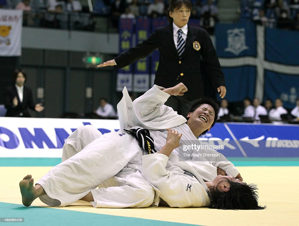 Ruika Sato (top) celebrates winning against Akari Ogata in the Women's -78kg during the Kodokan Cup All Japan Judo Championships By Weight Category at Chiba Port Arena on November 12, 2011 in Chiba, Japan.