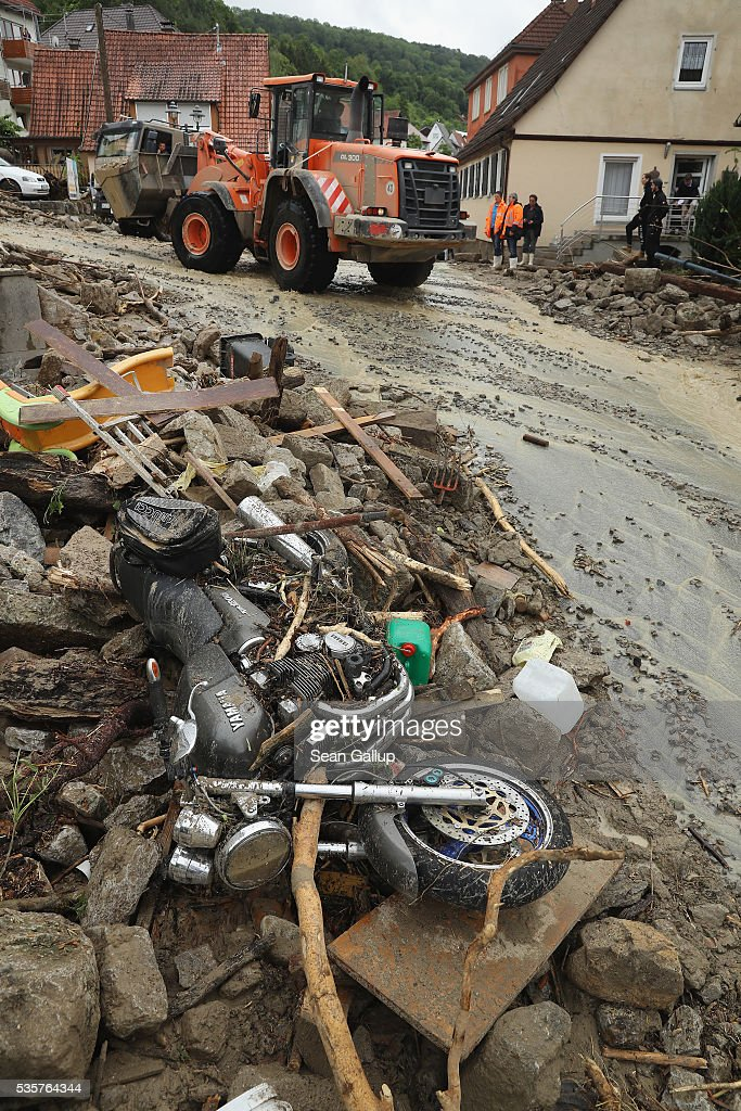 A ruined motorcycle lies among rocks and debris in the village center following a furious flash flood the night before on May 30, 2016 in Braunsbach, Germany. The flood tore through Braunsbach, crushing cars, ripping corners of houses and flooding homes during a storm that hit southwestern Germany. Miraculously no one in Braunsbach was killed, though three people died as a result of the storm in other parts of the country.