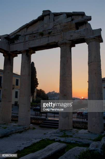 Ruined temple in Roman Agora at sunset.