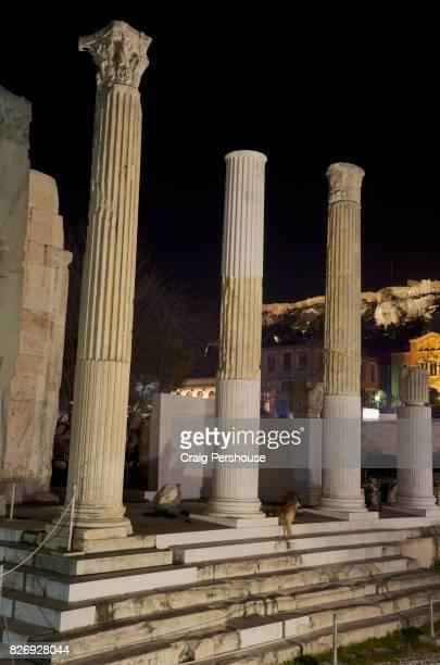Ruined temple in Roman Agora illuminated at night.